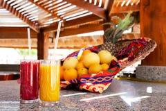 Fresh mango and strawberry juices Royalty Free Stock Image