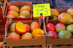 Fresh mangoes in cardboard boxes Royalty Free Stock Photos