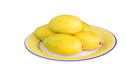 Fresh mangoes kept on the plate Royalty Free Stock Photo