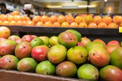 Fresh mangos. In the produce section at the grocery store Royalty Free Stock Photography