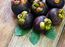 Fresh mangosteen fruit on wood Royalty Free Stock Images