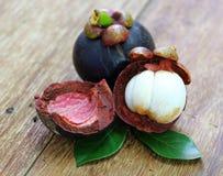 Fresh mangosteen fruit on wood Stock Photography