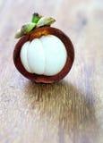 Fresh mangosteen fruit on wood Stock Photos