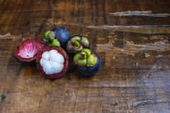 Fresh mangosteen fruit on a wooden table. Fresh mangosteen fruit on a wooden table stock images