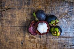 Fresh mangosteen fruit on a wooden table. Fresh mangosteen fruit on a wooden table royalty free stock image
