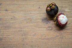 Fresh Mangosteen on wood. Background Stock Image