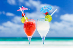 Fresh Margarita cocktails on table against tropical turquoise sea in the Caribbean sea Stock Photo