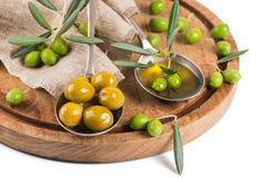 Fresh and marinaded olives, olive oil Royalty Free Stock Images