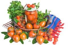 Fresh and marinaded tomatoes Stock Photos