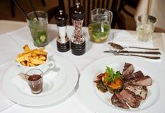 Fresh marinated beef steak served in restaurant Stock Photos