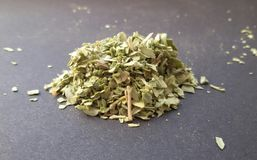 Fresh garden herbs. Marjoram over kitchen table. royalty free stock images