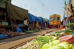 Fresh market sales of rail running through Royalty Free Stock Photo