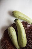 Fresh marrow on white Stock Photos