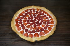 Fresh mascarpone pie. Mascarpone pie with fresh strawberries and raspberries on a wooden surface royalty free stock images