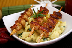 Fresh meal. A fresh meal of meat and noodles with spinach Royalty Free Stock Images