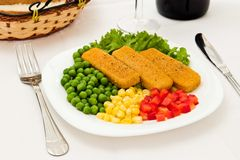Fresh meal. Fish dinner with vegetables at restaurant royalty free stock photography