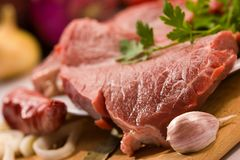 Fresh meat. Food serias: raw fresh meat with garlic and parsley Stock Image