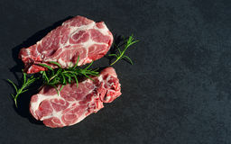 Fresh meat and aromatic herbs on black. Background Stock Photography