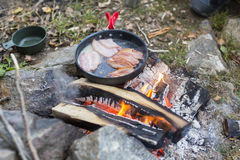 Fresh Meat Being Cooked Over Campfire Stock Photo