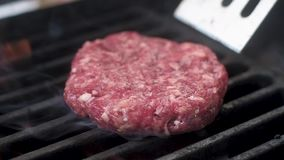 Fresh meat for burgers put on the grill.  slow motion. Fresh meat for burgers put on the grill stock video footage