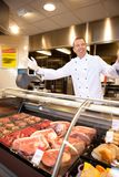 Fresh meat with cheerful butcher Stock Images