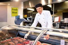 Fresh Meat Counter with Butcher Royalty Free Stock Images