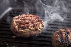Fresh meat cutlets in a frying pan grill Royalty Free Stock Photography