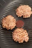 Fresh meat cutlets in a frying pan grill Stock Image
