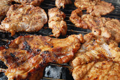Fresh meat on grill Stock Photography