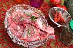 Fresh meat of a lamb. Some fresh meat of a lamb with rosemary Royalty Free Stock Photo