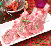 Fresh meat of lamb. Some fresh meat of lamb with rosemary Stock Image