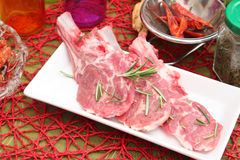 Fresh meat of lamb. Some fresh meat of lamb with rosemary Stock Photos