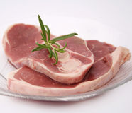Fresh meat of a lamp. Some fresh, raw meat of a lamp with rosemary Royalty Free Stock Photo
