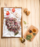 Fresh meat in marinade and spices ready to cook. Food background.  Stock Photos
