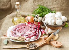Fresh meat with mushrooms spices , herbs. Royalty Free Stock Image
