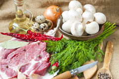 Fresh meat with mushrooms spices herbs. Fresh meat with mushrooms spices and herbs Royalty Free Stock Images