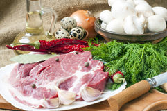 Fresh meat with mushrooms spices  herbs. Fresh meat with mushrooms spices and herbs Royalty Free Stock Photography