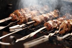 Fresh Meat On A Steel Skewer In A Brazier Royalty Free Stock Photos