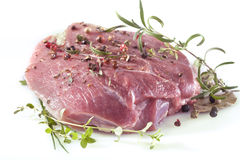 Fresh meat. With pepper, mint, rosemary, thyme and spices Royalty Free Stock Photography