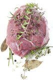 Fresh meat. With pepper, mint, rosemary, thyme and spices Stock Photos