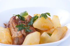 Meat and potatoes with parsley Stock Photography
