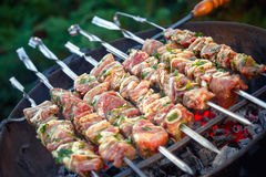 Fresh meat preparing on grill Royalty Free Stock Images
