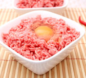 Fresh meat with a raw egg Stock Photography