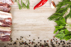 Fresh meat : raw pork meat with red chili pepper, dill, garlic and  rosemary. On wooden board Royalty Free Stock Photos