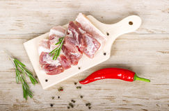Fresh meat : raw pork meat with red chili pepper, dill and  rosemary on wooden board. Fresh meat : raw pork meat with red chili pepper, dill and rosemary on the Royalty Free Stock Photo