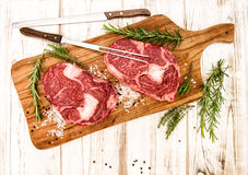 Fresh meat Ribeye Steak with herbs and spices. Food background Stock Photo
