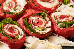 Fresh meat rolls with cheese and  green salad Stock Image