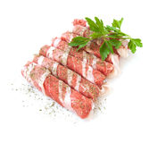 Fresh meat rolls with spices isolated on white background Royalty Free Stock Images