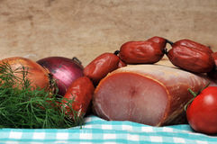 Fresh meat and sausages. Still life concept Stock Images