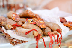 Fresh meat sausages with red strings on white Stock Images